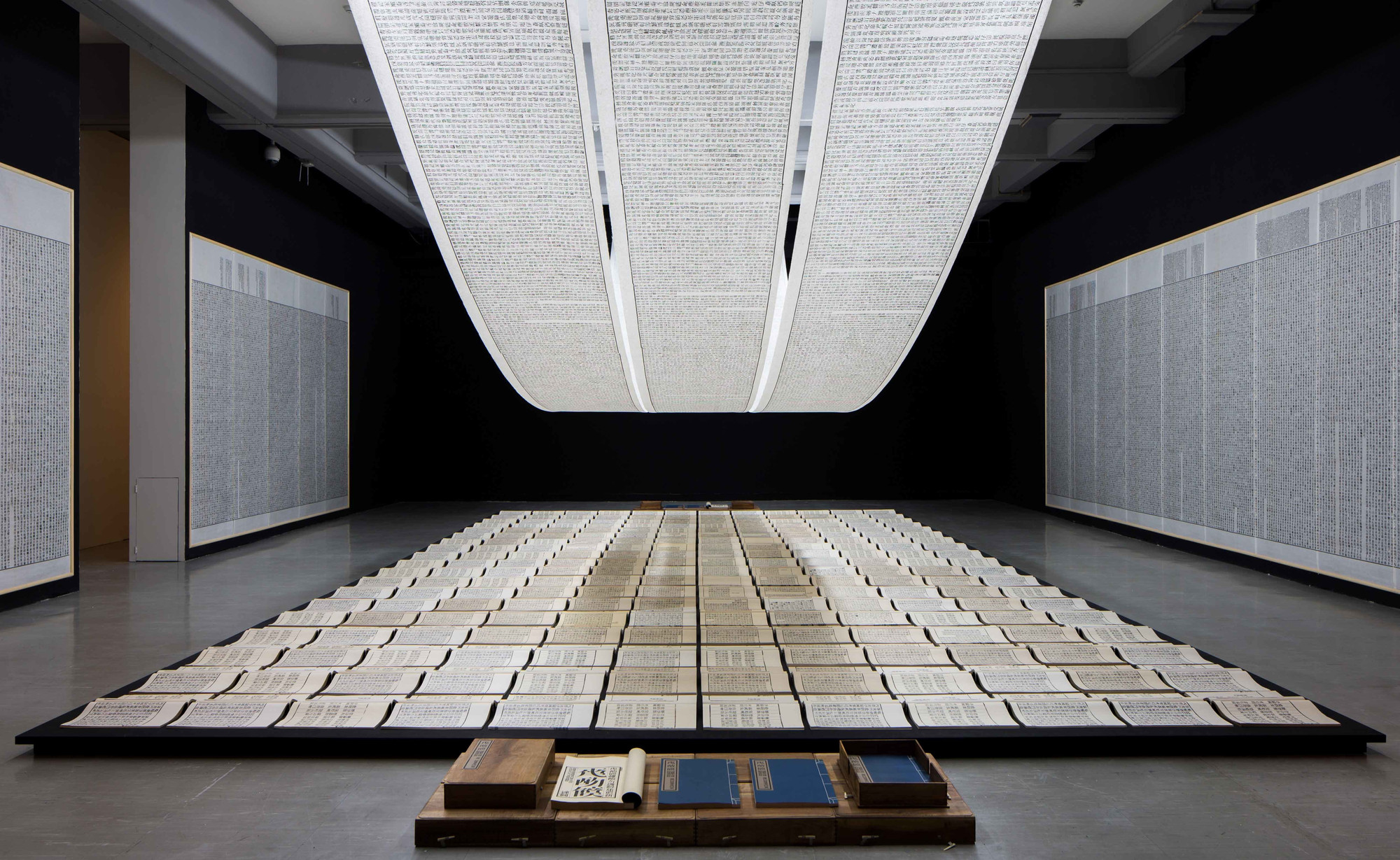 "Xu Bing. Book from the Sky. 1987–91. Mixed media installation/hand-printed books and scrolls printed from blocks inscribed with ""false"" Chinese characters. Installation view at Taipei Fine Arts Museum, 2014. © Xu Bing Studio"
