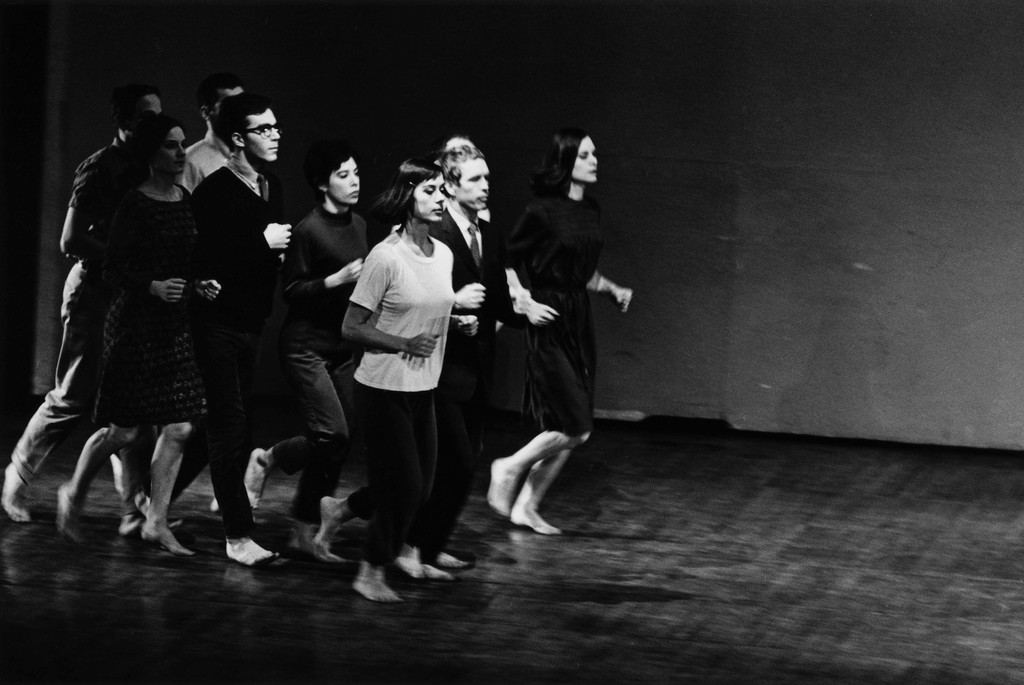 Peter Moore's photograph of Robert Rauschenberg, Joseph Schlichter (back), Sally Gross, Tony Holder, Deborah Hay, and Robert Morris (middle), Yvonne Rainer, Alex Hay, and Lucinda Childs (front) in *We Shall Run*, 1963. Performed in Two Evenings of Dances by Yvonne Rainer, Wadsworth Atheneum, Hartford, Connecticut, March 7, 1965. © Barbara Moore/Licensed by VAGA at ARS, NY. Courtesy Paula Cooper Gallery, New York