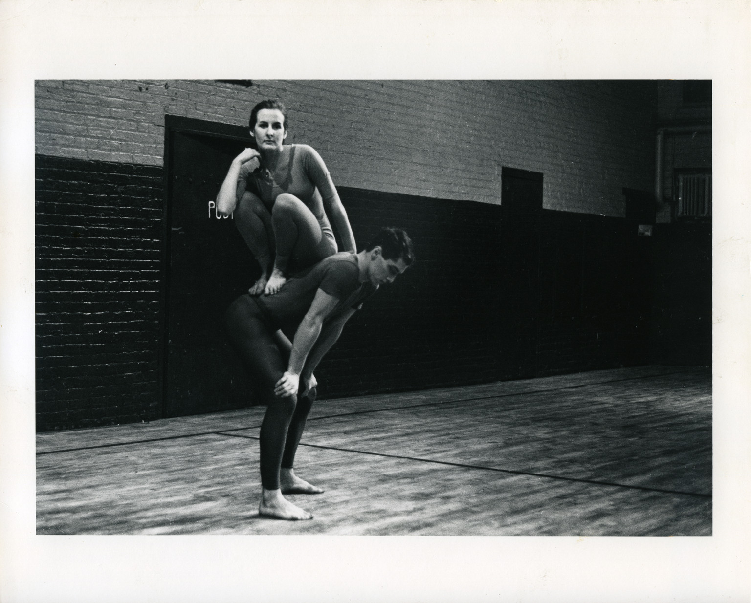 Peter Moore's photograph of Trisha Brown and Steve Paxton in Brown's Lightfall. Performed at Concert of Dance #4, Judson Memorial Church, January 30, 1963. © Barbara Moore/Licensed by VAGA, New York, NY. Courtesy Paula Cooper Gallery, New York