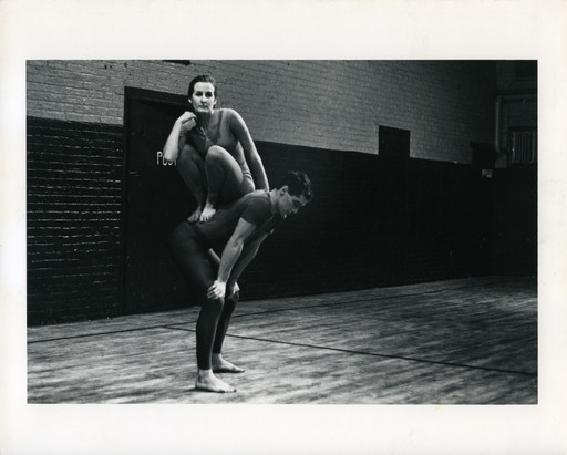 Peter Moore's photograph of Trisha Brown and Steve Paxton in Brown's _Lightfall_. Performed at _Concert of Dance #4_, Judson Memorial Church, January 30, 1963. © Barbara Moore/Licensed by VAGA, New York, NY. Courtesy Paula Cooper Gallery, New York