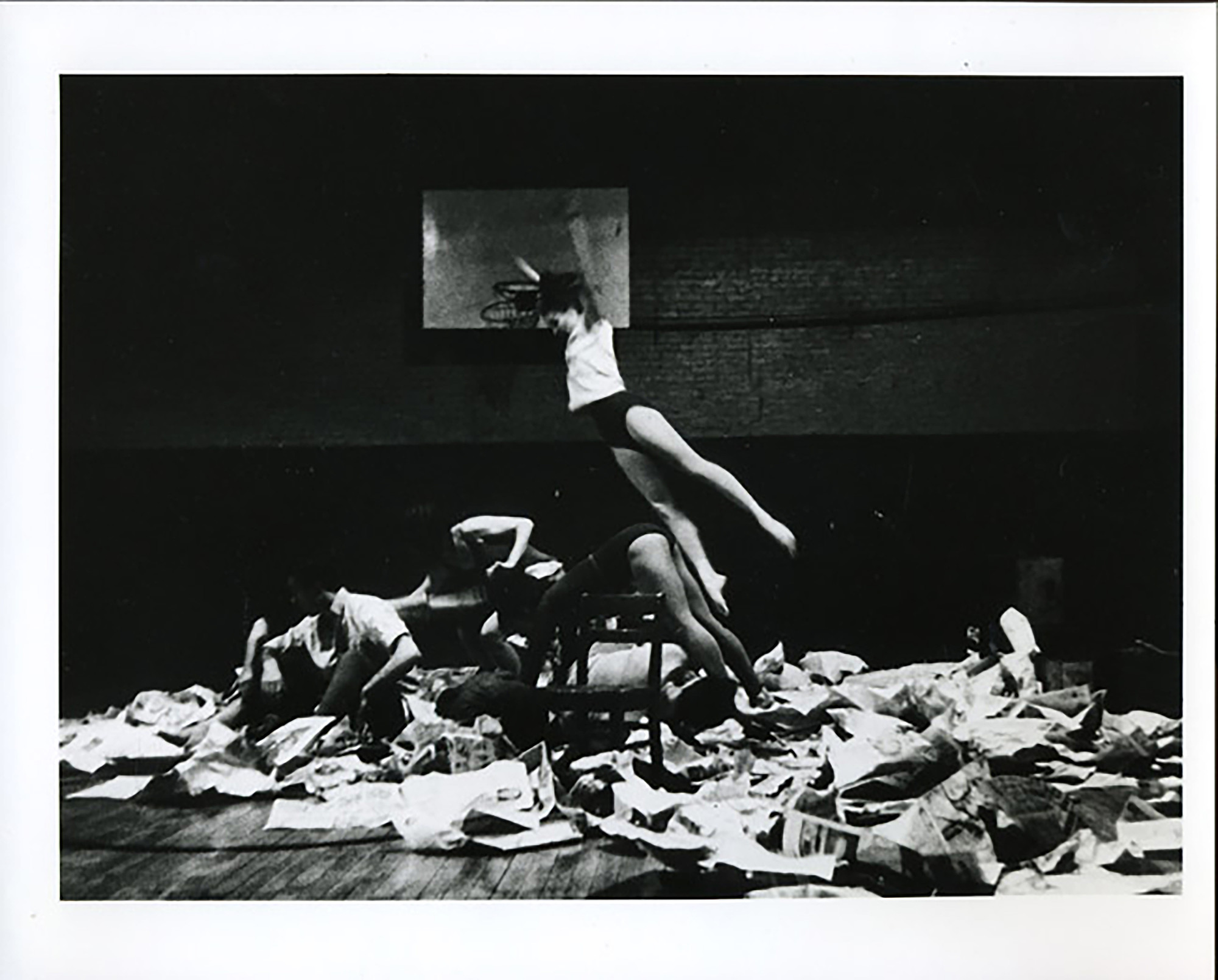 Al Giese's photograph of Ruth Emerson in Carolee Schneemann's _Newspaper Event_. Performed at _Concert of Dance #3_, Judson Memorial Church, January 29, 1963. © Estate of Al Giese/Licensed by VAGA, New York, NY. Courtesy of Carolee Schneemann, Galerie Lelong & Co., and P•P•O•W, New York