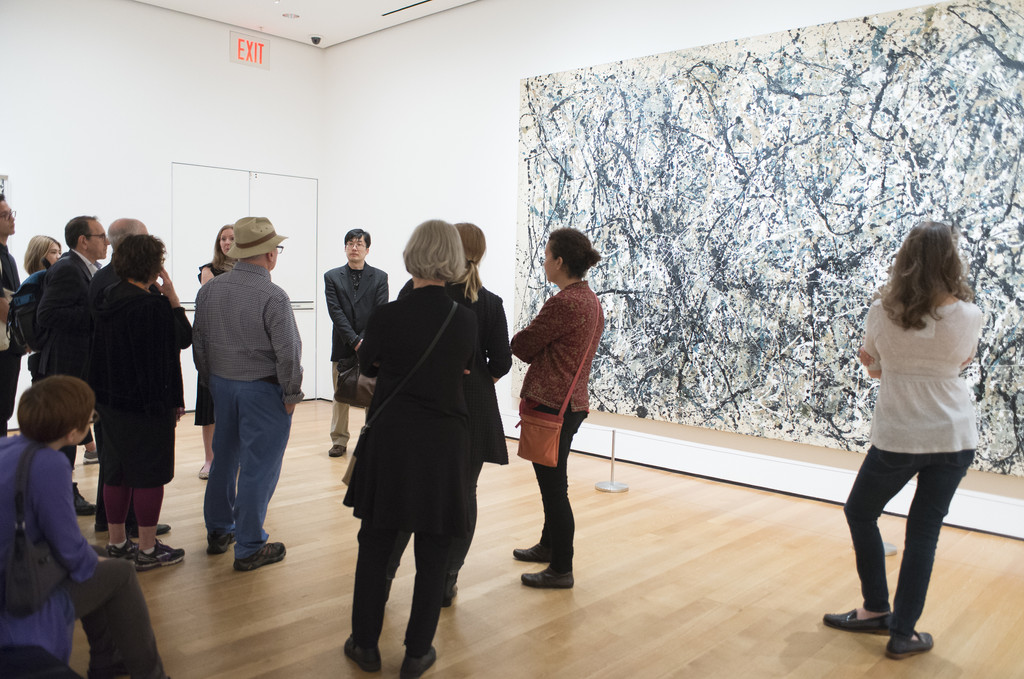 "Member tour. On wall: Jackson Pollock. *One: Number 31, 1950*. 1950. Oil and enamel paint on canvas. 8' 10"" x 17' 5 5/8"" (269.5 x 530.8 cm). Sidney and Harriet Janis Collection Fund (by exchange). Conservation was made possible by the Bank of America Art Conservation Project. © 2018 Pollock-Krasner Foundation / Artists Rights Society (ARS), New York. Photo: Fiona Veronique"