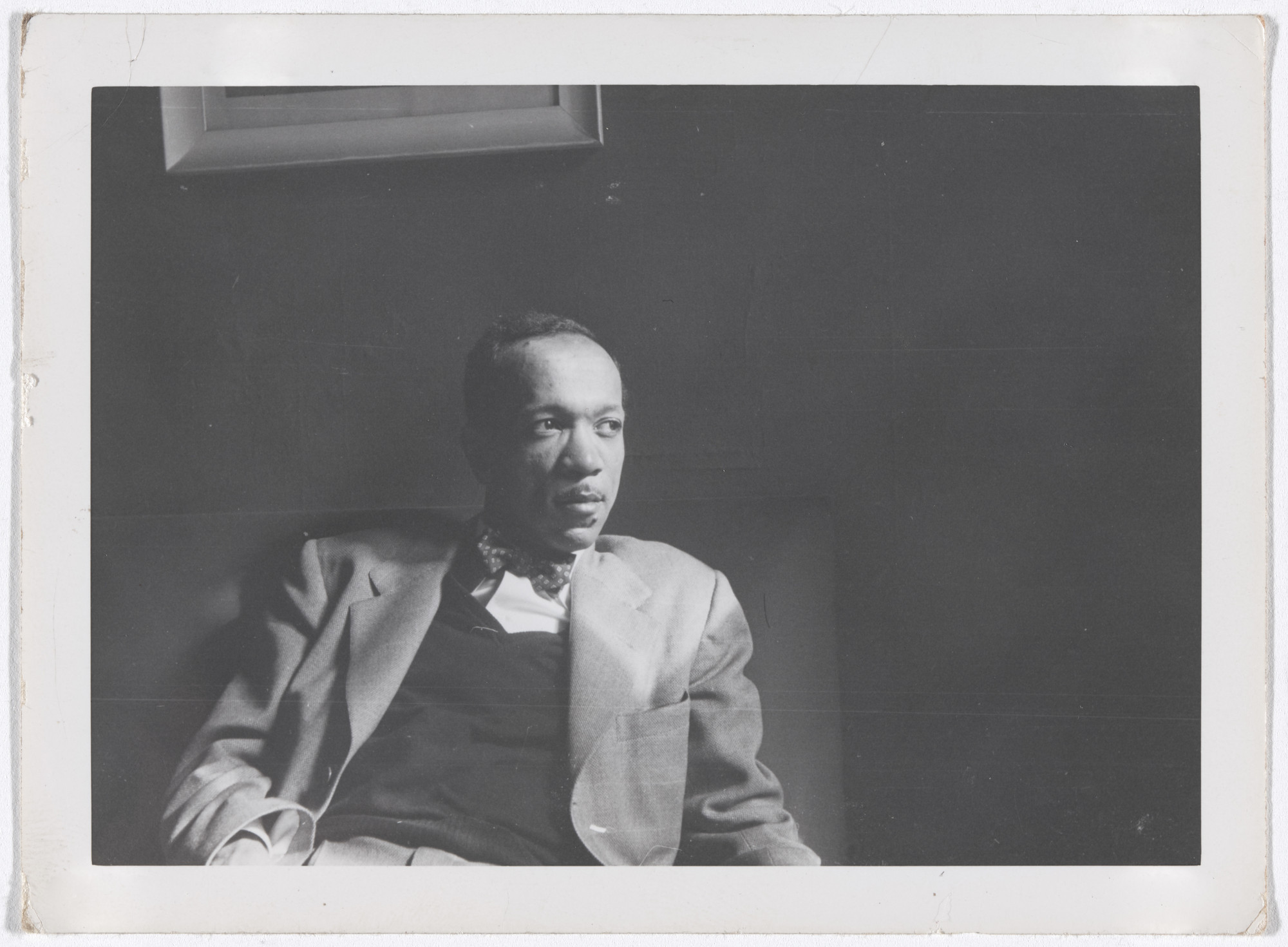 "Unknown photographer. Charles White, c. 1950. Black-and-white photograph, 3 5/16 × 4 9/16"" (8.4 × 11.6 cm). Private collection. © The Charles White Archives"