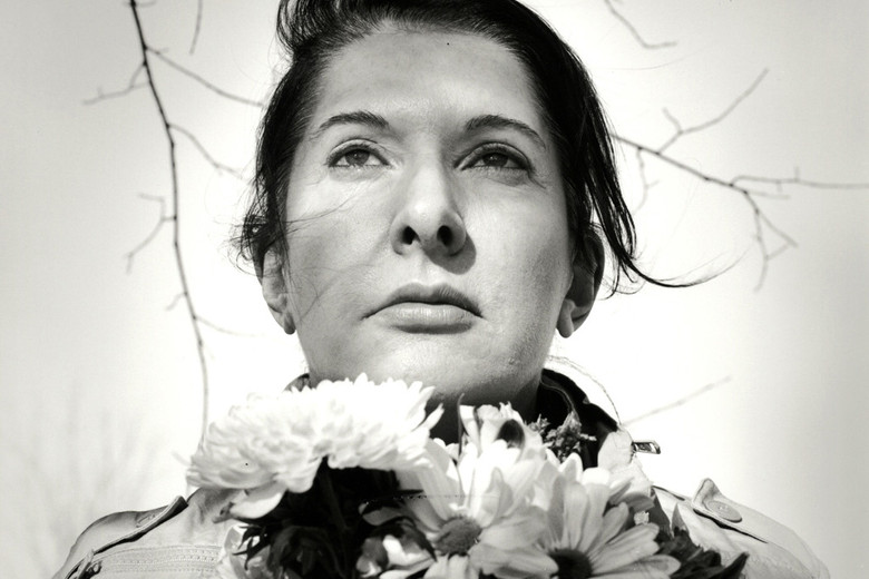 Marina Abramović. Portrait with Flowers. 2009. Black-and-white gelatin silver print; photo: Marco Anelli. © 2010 Marina Abramović. Courtesy the artist and Sean Kelly Gallery/Artists Rights Society (ARS), New York