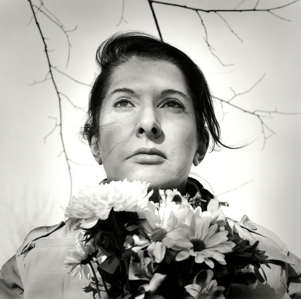 Marina Abramović. _Portrait with Flowers._ 2009. Black-and-white gelatin silver print; photo: Marco Anelli. © 2010 Marina Abramović. Courtesy the artist and Sean Kelly Gallery/Artists Rights Society (ARS), New York