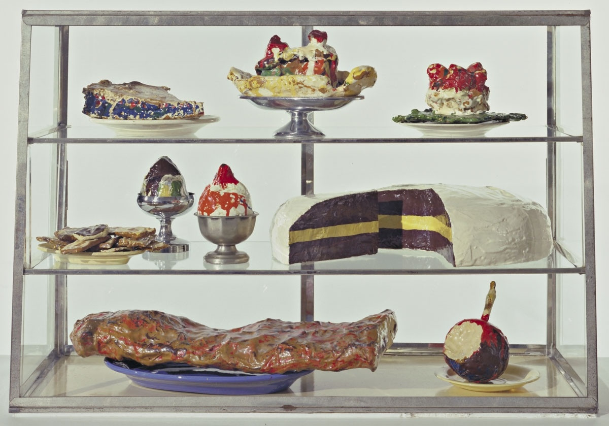 "Pastry Case, I Date: 1961-62 Medium: Burlap and muslin soaked in plaster, painted with enamel, metal bowls, and ceramic plates in glass-and-metal case Dimensions: 20 3/4 x 30 1/8 x 14 3/4"" (52.7 x 76.5 x 37.3 cm) Credit Line: The Sidney and Harriet Janis Collection MoMA Number: 639.1967.a-dd"