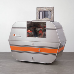 "Andrea Zittel, A-Z Escape Vehicle: Customized by Andrea Zittel, 1996. Exterior: steel, insulation, wood and glass. Interior: colored lights, water, fiberglass, wood, papier-mâché, pebbles and paint, 62"" x 7' x 40"" (157.5 x 213.3 x 101.6 cm). The Norman and Rosita Winston Foundation, Inc. Fund and an anonymous fund. © 2012 Andrea Zittel."