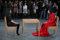 Installation view of Marina Abramović's performance The Artist Is Present at The Museum of Modern Art, 2010. Photo by Scott Rudd. For her longest solo piece to date, Abramović will sit in silence at a table in the Museum's Donald B. and Catherine C. Marron Atrium during public hours, passively inviting visitors to take the seat across from her for as long as they choose within the timeframe of the Museum's hours of operation. Although she will not respond, participation by Museum visitors completes the piece and allows them to have a personal experience with the artist and the artwork. © 2010 Marina Abramović. Courtesy the artist and Sean Kelly Gallery/Artists Rights Society (ARS), New York