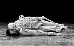 "Marina Abramović. Nude with Skeleton. 2002-05. Black-and-white photograph. 50 x 80¼"" (125 x 145 cm). © 2010 Marina Abramović. Courtesy the artist and Sean Kelly Gallery/Artists Rights Society (ARS), New York. Reperformed continuously in shifts throughout the exhibition Marina Abramović: The Artist Is Present at MoMA, March 14-May 31, 2010."