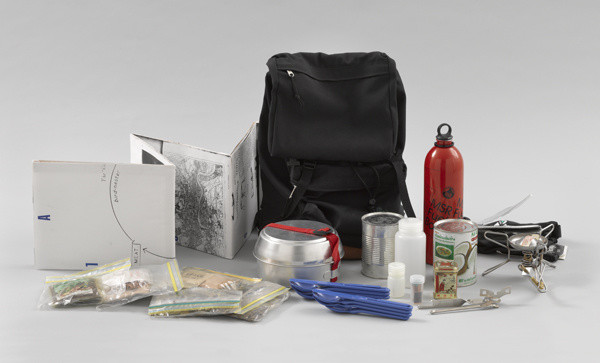 "Rirkrit Tiravanija. _Untitled (Rucksack Installation)_. 1993. Multiple of backpack, map, camping stove, dishes, can opener, and ingredients for a Thai rice meal rucksack (approx.): 15 3/4 x 12 5/8 x 11 7/16"" (40 x 32 x 29cm); sheet (map): 76 5/16 x 68 1/8"" (193.9 x 173 cm). The Museum of Modern Art. Purchased with funds given by Linda Barth Goldstein."
