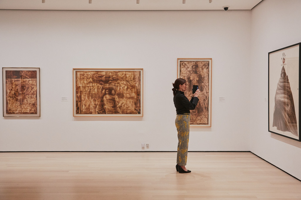 Visitor in *Charles White: A Retrospective* at The Museum of Modern Art, New York, October 7, 2018–January 13, 2019. Photo: Christiana Rifaat