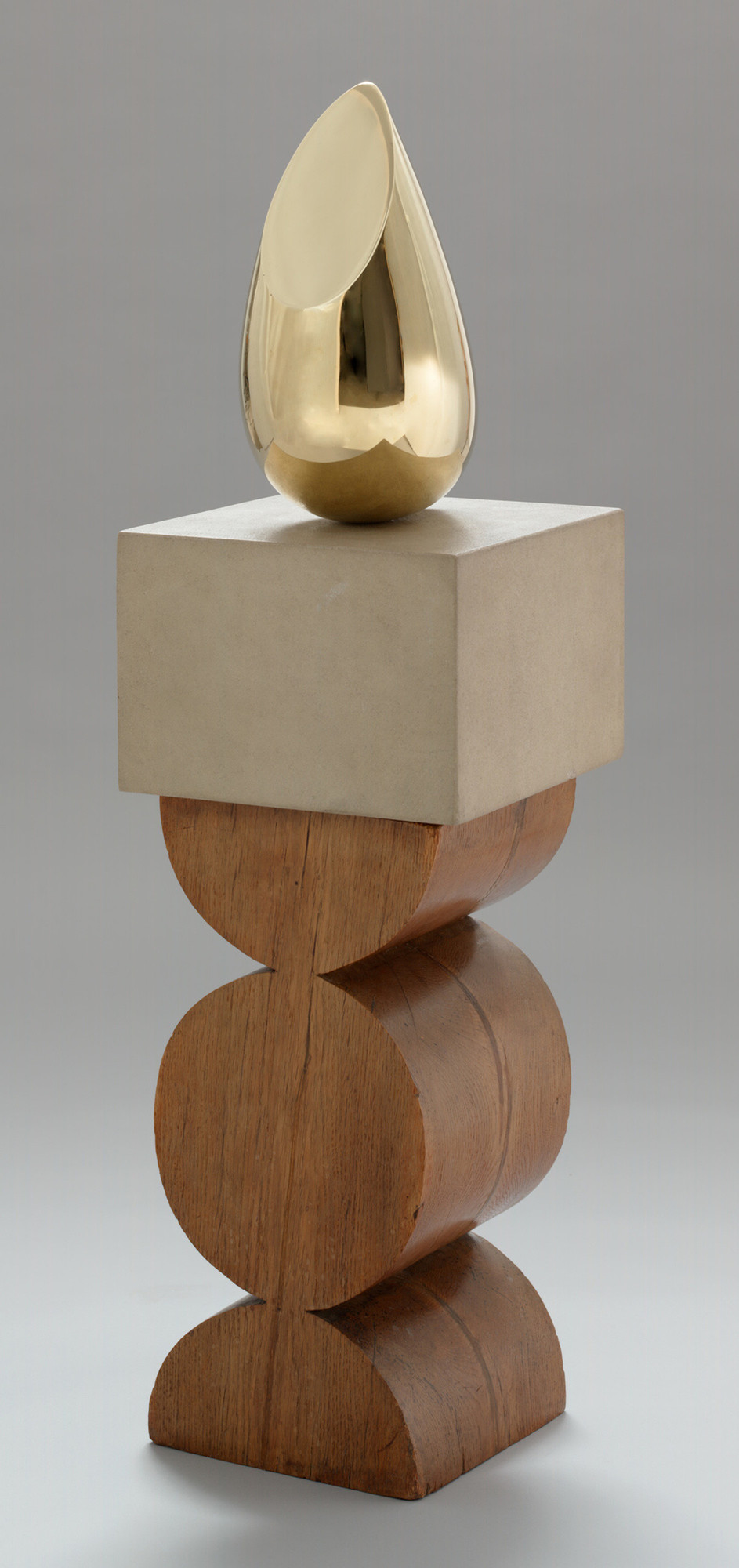 "Constantin Brancusi. Young Bird. 1928. Bronze, 16 x 8 1/4 x 12"" (40.5 x 21 x 30.4 cm), on a two-part pedestal of limestone, 9 1/4"" (23.5 cm) high, and oak, 23 3/4"" (60.3 cm) high (carved by the artist), 16 × 8 1/4 × 12"" (40.6 × 21 × 30.5 cm); other (stone): 9 1/4"" (23.5 cm); pedestal (overall): 36 × 13 1/2 × 14"" (91.4 × 34.3 × 35.6 cm). Gift of Mr. and Mrs. William A. M. Burden. © Succession Brancusi - All rights reserved (ARS) 2018"