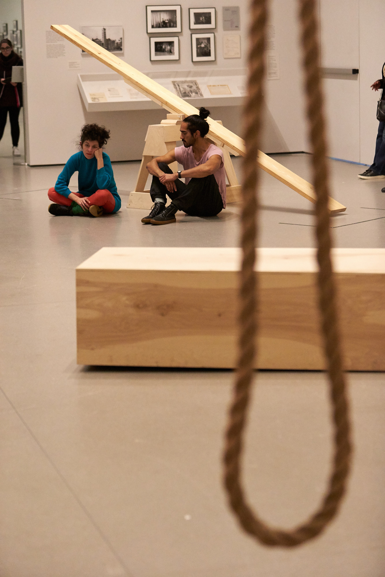 Sound escapes through the small crack at one side of the plywood box. Lee Relvas and Miguel Ángel Guzmán sit on the floor, listening quietly for the duration of the piece.