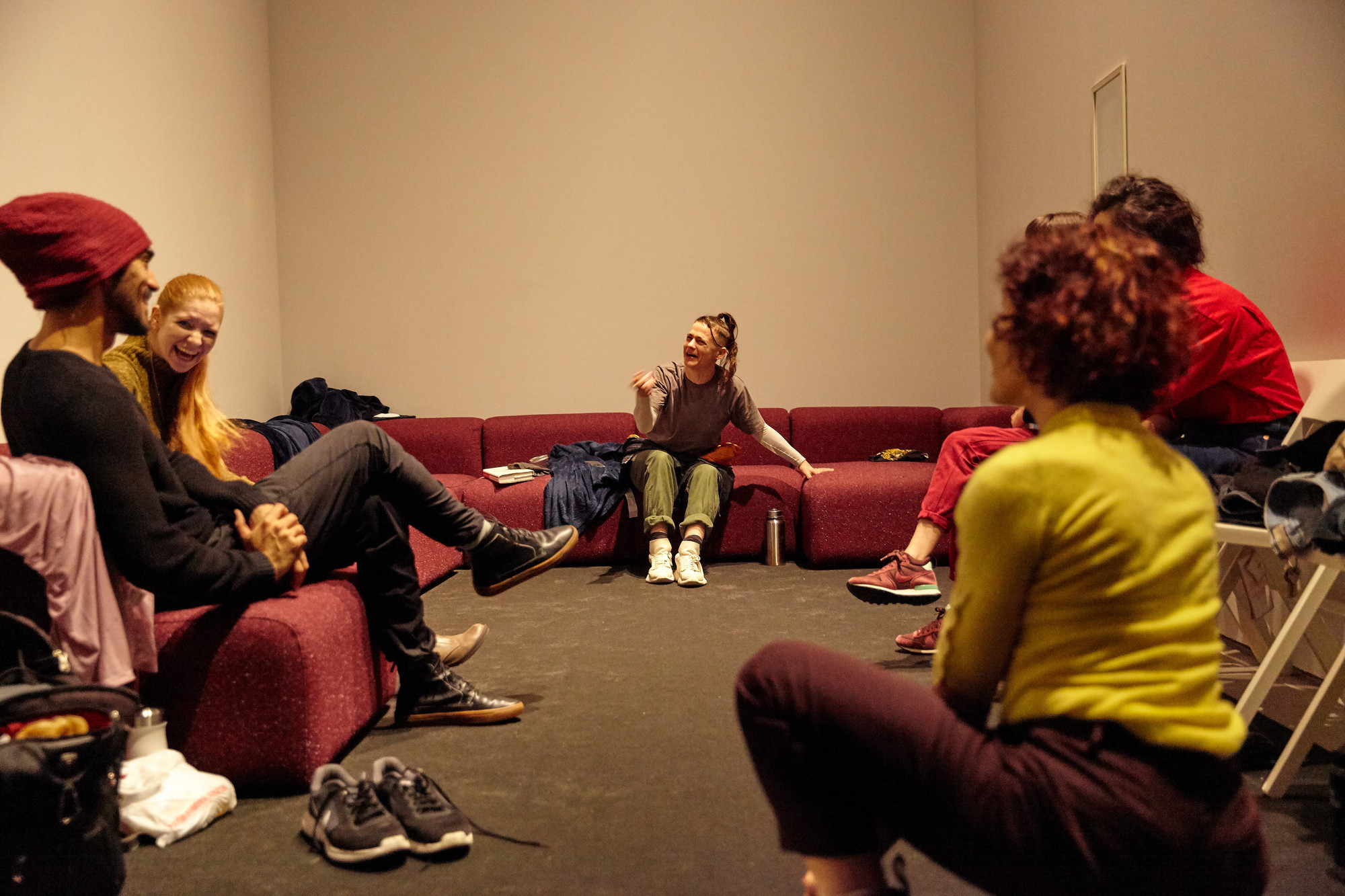 The cast assembles in the green room, a private space built into the floor plan of the exhibition where performers rest and warm up between performances. Assistant performance coordinator Sammy Roth is on hand to ensure they have everything they need.