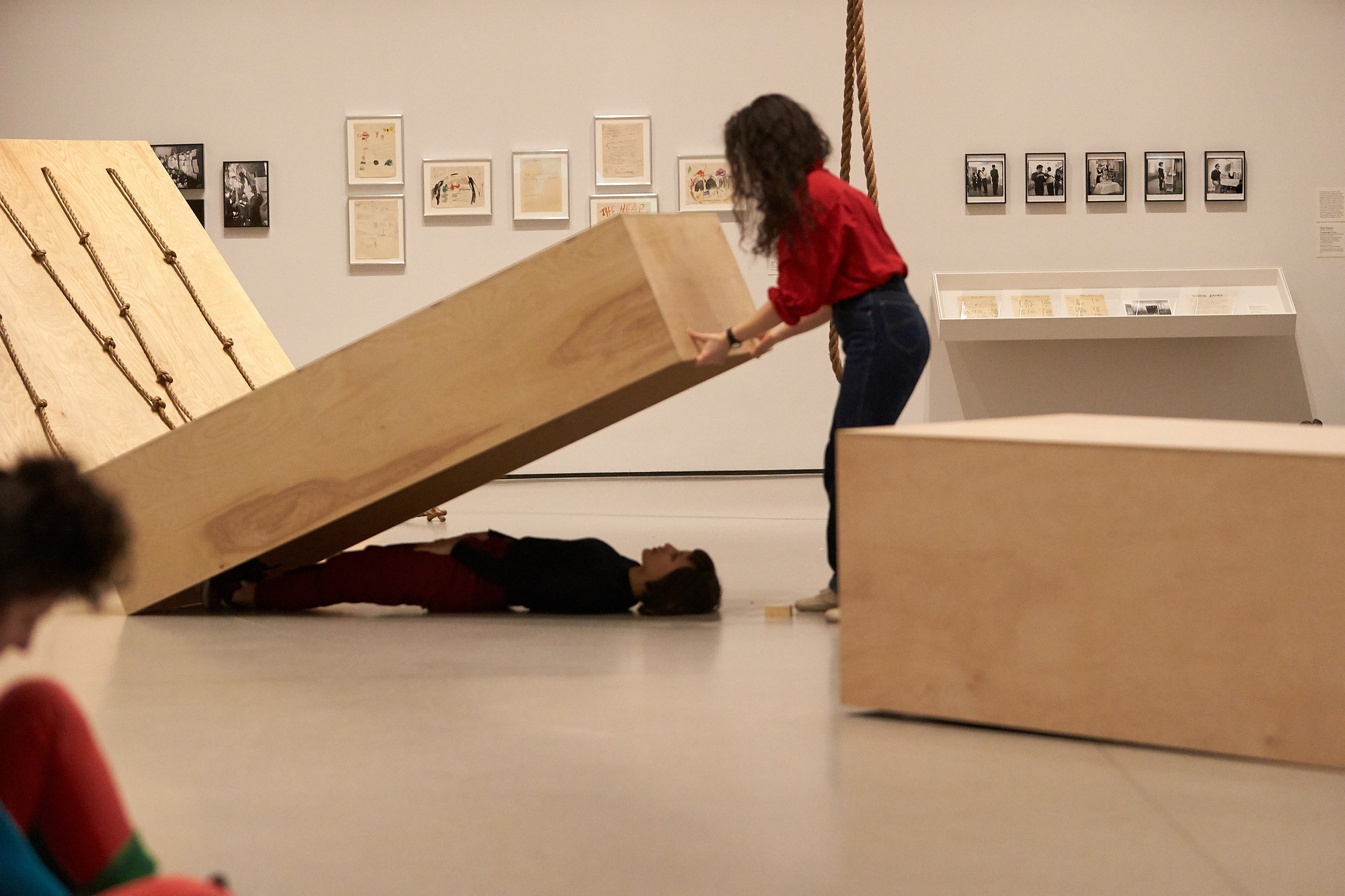 In Platforms, Vanessa Vargas and Christiana Cefalu lie on the floor beneath plywood boxes of different sizes. Forti has described this piece as akin to lovers asleep next to each other; they are both together yet in their own separate worlds. Vanessa and Christiana whistle with each other in an intimate duet.