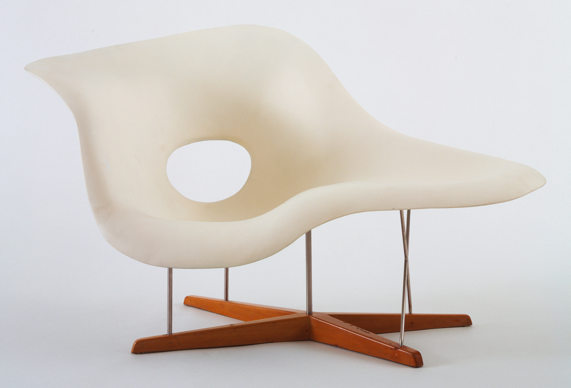 "Charles Eames, Ray Eames. Prototype for Chaise Longue (La Chaise). 1948. Hard rubber foam, plastic, wood, and metal, 32 1/2 x 59 x 34 1/4"" (82.5 x 149.8 x 87 cm). Gift of the designers"