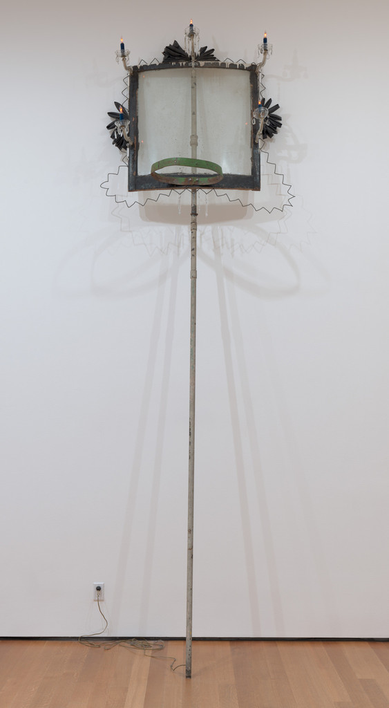 "David Hammons. *High Falutin'.* 1990. Metal (some parts painted with oil), oil on wood, chandelier parts, rubber, velvet, plastic, and light bulbs, 13' 2"" x 48"" x 30 1/2"" (396 x 122 x 77.5 cm). Robert and Meryl Meltzer Fund and purchase. © 2019 David Hammons"