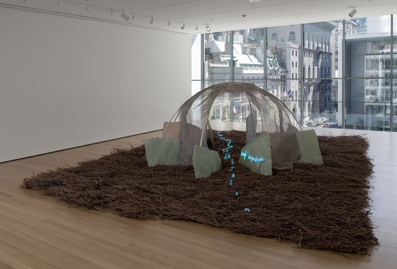 "Mario Merz. Places with No Street. 1987. Aluminum, wire mesh, stones, twigs, neon tubing, and wires, overall dimensions variable, approximately 6' 6 ¾"" x 21' x 28' (200 x 640.5 x 854 cm). Sid R. Bass Fund and Enid A. Haupt Fund. © 2019/Artists Rights Society (ARS), New York/SIAE, Rome"