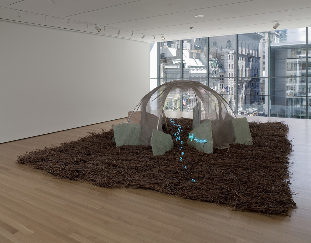 "Mario Merz. *Places with No Street.* 1987. Aluminum, wire mesh, stones, twigs, neon tubing, and wires, overall dimensions variable, approximately 6' 6 3/4"" x 21' x 28' (200 x 640.5 x 854 cm). Sid R. Bass Fund and Enid A. Haupt Fund. © 2019/Artists Rights Society (ARS), New York/SIAE, Rome"