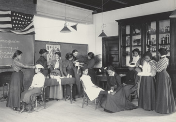 "Frances Benjamin Johnston. Physiology. Class in emergency work. From The Hampton Album. 1899–1900. One from an album of 159 platinum prints, 7 9/16 × 9 ½"" (19.2 × 24.2 cm). The Museum of Modern Art, New York. Gift of Lincoln Kirstein"