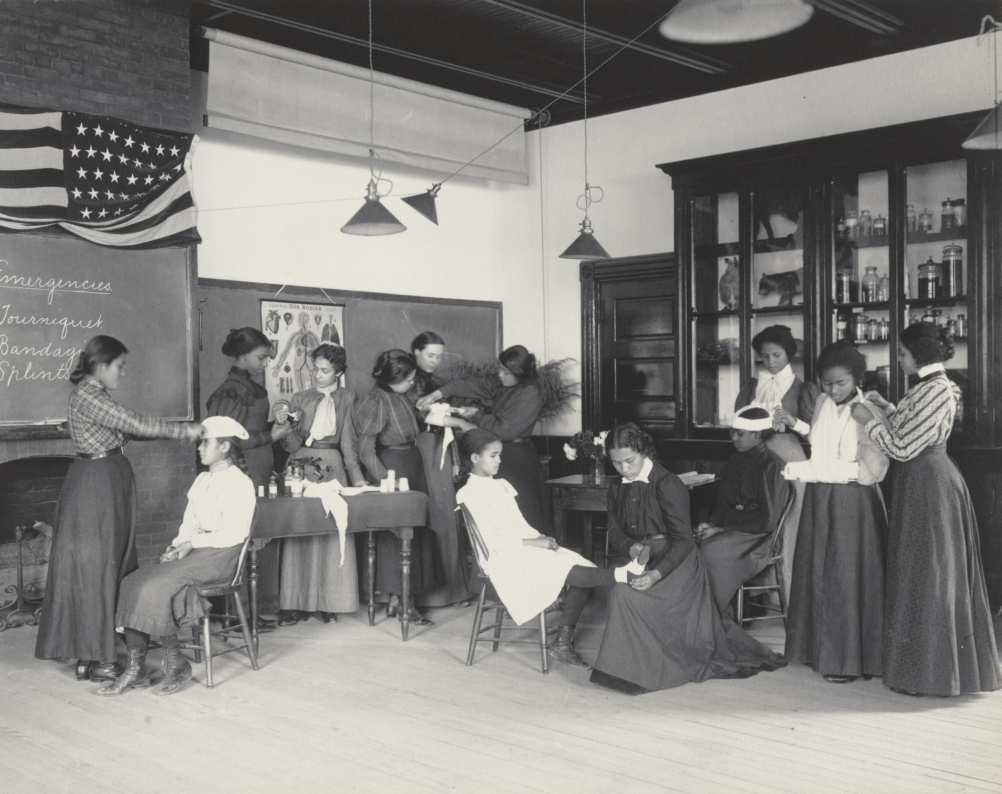 "Frances Benjamin Johnston. Physiology. Class in emergency work. From The Hampton Album. 1899–1900. One from an album of 159 platinum prints, 7 9/16 × 9 1/2"" (19.2 × 24.2 cm). The Museum of Modern Art, New York. Gift of Lincoln Kirstein"