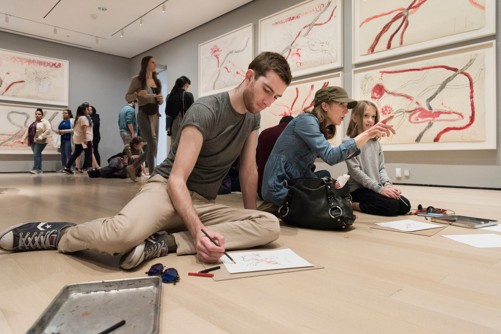 Visitors participating in activities in *Louise Bourgeois: An Unfolding Portrait*. The Museum of Modern Art, New York, September 24, 2017–January 28, 2018. © The Easton Foundation/VAGA at ARS, NY. Photo: Martin Seck