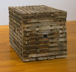 "Jackie Winsor. Burnt Piece. 1977-78. Cement, burnt wood, and wire mesh, 33 7/8 x 34 x 34"" (86.1 x 86.4 x 86.4 cm). Gift of Agnes Gund. © 2019 Jackie Winsor"