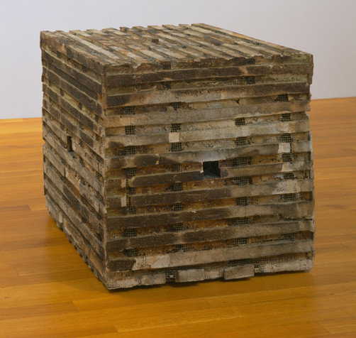 "Jackie Winsor. _Burnt Piece_. 1977-78. Cement, burnt wood, and wire mesh, 33 7/8 x 34 x 34"" (86.1 x 86.4 x 86.4 cm). Gift of Agnes Gund. © 2019 Jackie Winsor"