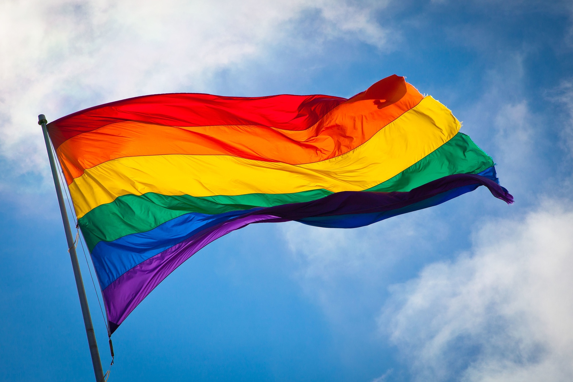 The Rainbow Flag waving in the wind at San Francisco's Castro District. Photo: Benson Kua. Image used through Creative Commons Attribution-ShareAlike 2.0 Generic