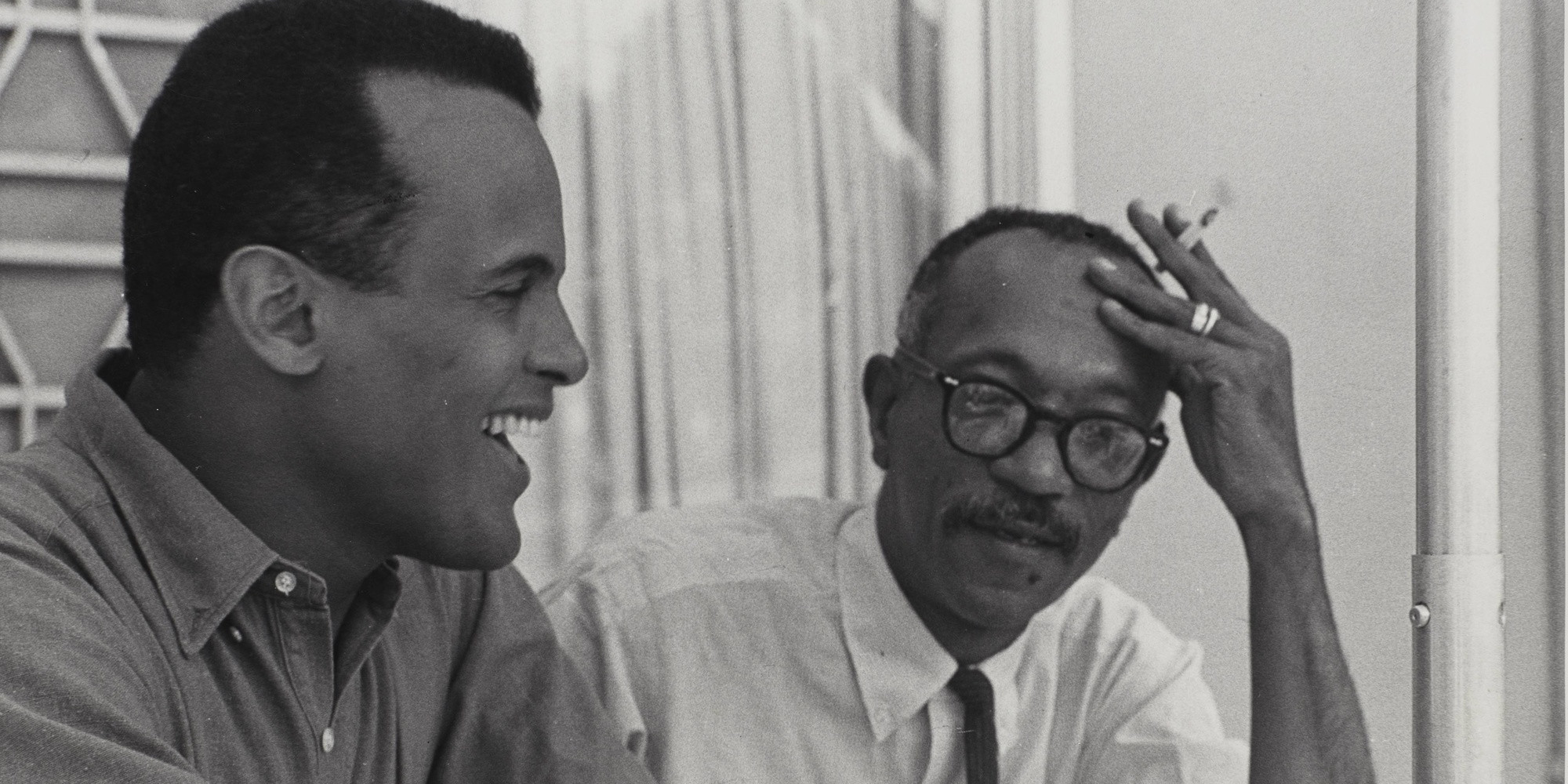 Charles White and Harry Belafonte working on Songs Belafonte Sings. c. 1960. Black-and-white photograph. © The Charles White Archives