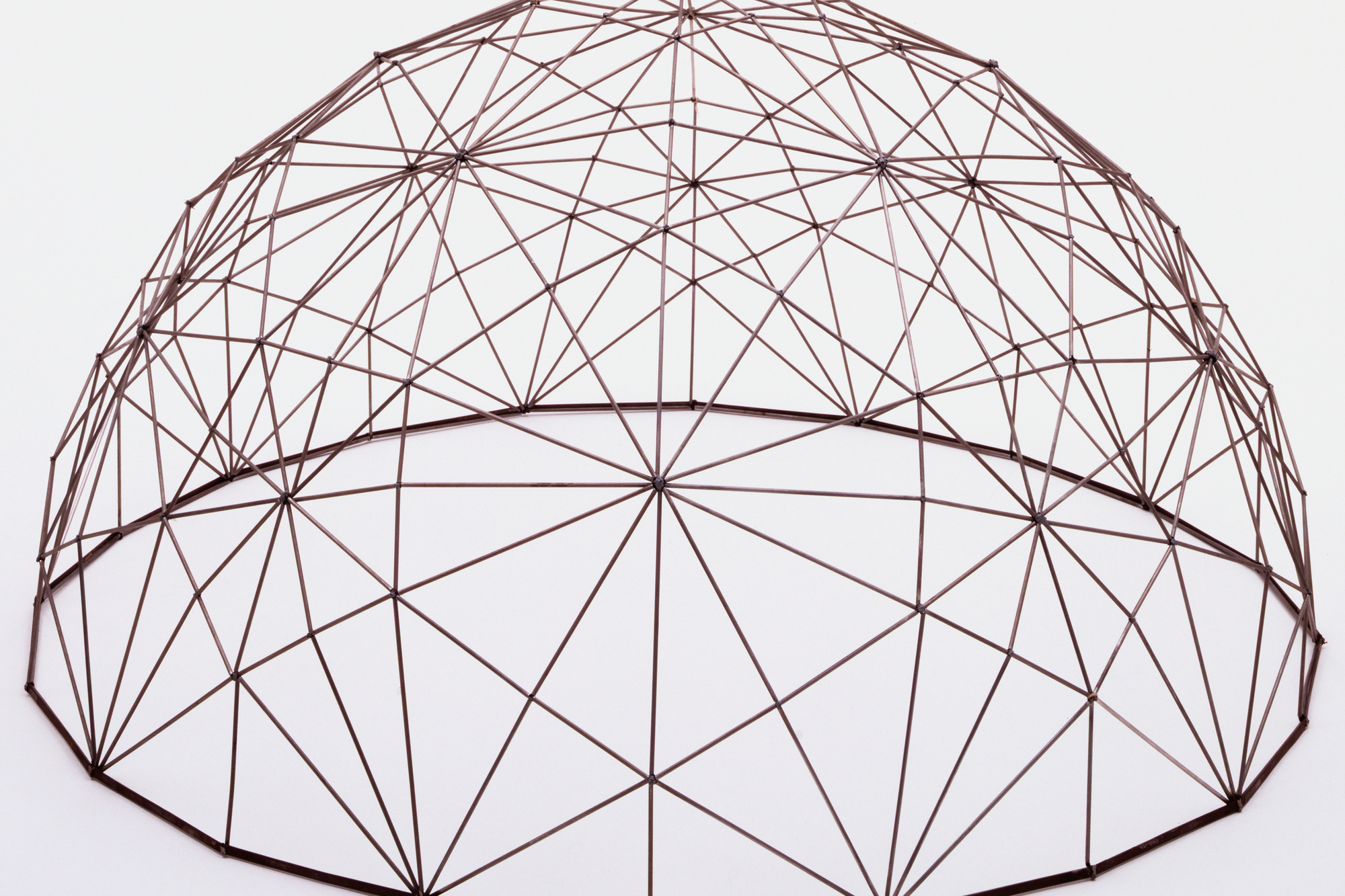 "R. Buckminster Fuller. Geodesic Dome. 1952. Elastic cord and metal, h. 20 1/4"" (51.4 cm), diam. 39"" (99.1 cm). Model maker: Alan Borg, Joan Forrester, Ron Goodfellow, John Hampshire, T. C. Howard, Fred Taylor. Gift of the architect"