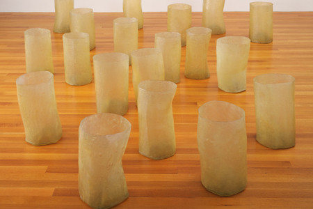 Eva Hesse. <em>Repetition Nineteen III</em>. 1968. Fiberglass and polyester resin, 19 units, each 19 to 20 1/4&quot; (48 to 51 cm) × 11 to 12 3/4&quot; (27.8 to 32.2 cm) in diameter. Gift of Charles and Anita Blatt. © 2019 Estate of Eva Hesse. Galerie Hauser &amp; Wirth, Zurich