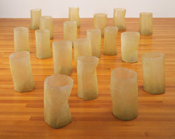 "Eva Hesse. Repetition Nineteen III. 1968. Fiberglass and polyester resin, 19 units, each 19 to 20 1/4"" (48 to 51 cm) × 11 to 12 3/4"" (27.8 to 32.2 cm) in diameter. Gift of Charles and Anita Blatt. © 2019 Estate of Eva Hesse. Galerie Hauser & Wirth, Zurich"