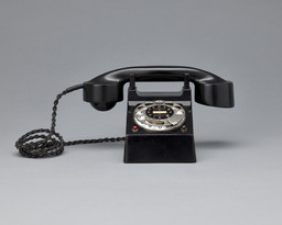"Richard Schadewell. Frankfurt (""Bauhaus"") telephone. 1929. Manufacturer: H. Fuld & Co. Telefon und Telegraphenwerke AG, Frankfurt. Bakelite, nickel-plated sheet brass and paint, 5 1/8 × 4 5/16 × 6 1/8"" (13 × 11 × 15.5 cm). Gift of Jo Carole and Ronald S. Lauder"