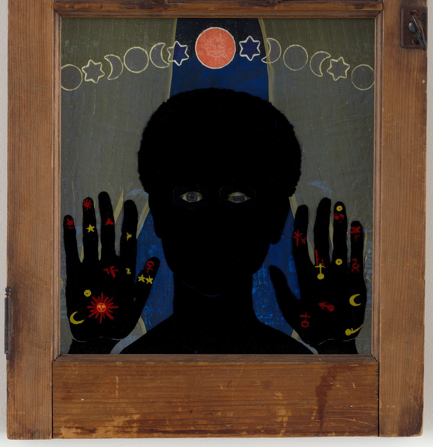 "Betye Saar. _Black Girl's Window. 1969. Wooden window frame with paint, cut-and-pasted printed and painted papers, daguerreotype, lenticular print, and plastic figurine. 35 3⁄4 x 18 x 1 1⁄2"" (90.8 x 45.7 x 3.8 cm). Gift of Candace King Weir through The Modern Women'sFund, and Committee on Painting and Sculpture Funds"