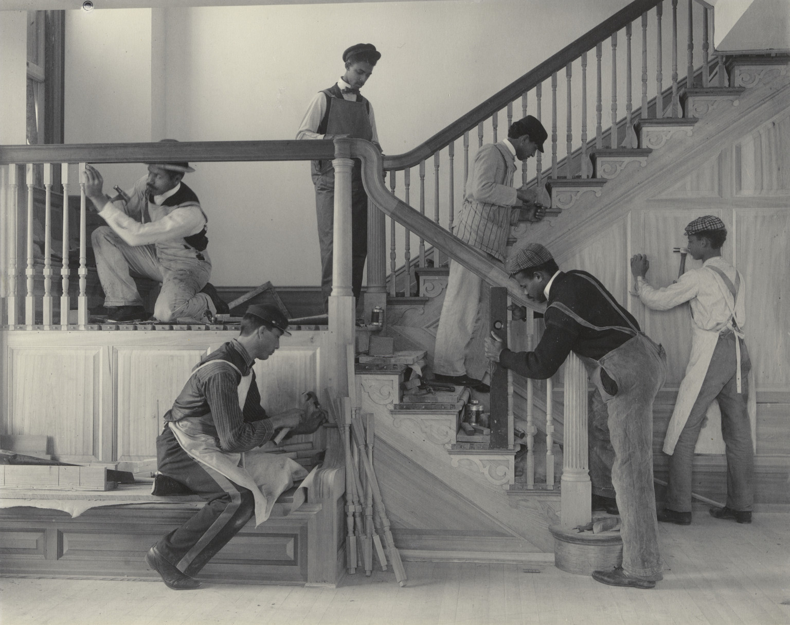 "Frances Benjamin Johnston. Stairway of the Treasurer's Residence: Students at Work from the Hampton Album. 1899-1900. Platinum print. 7 9⁄16 × 9 9⁄16"" (19.2 × 24.3 cm). Gift of Lincoln Kirstein"