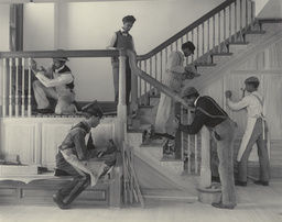 "Frances Benjamin Johnston. Stairway of the Treasurer's Residence: Students at Work from the Hampton Album. Platinum print, 7 9/16 × 9 9/16"" (19.2 × 24.3 cm). Gift of Lincoln Kirstein"