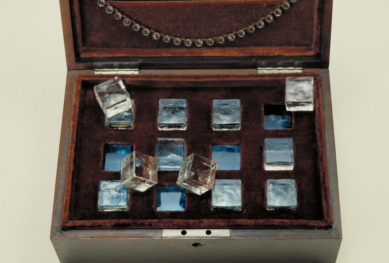 "Joseph Cornell. Taglioni's Jewel Casket.1940. Velvet-lined wooden box containing glass necklace, jewelry fragments, glass chips, and glass cubes resting in slots on glass, 4 3/4 x 11 7/8 x 8 1/4"" (12 x 30.2 x 21 cm). Gift of James Thrall Soby"