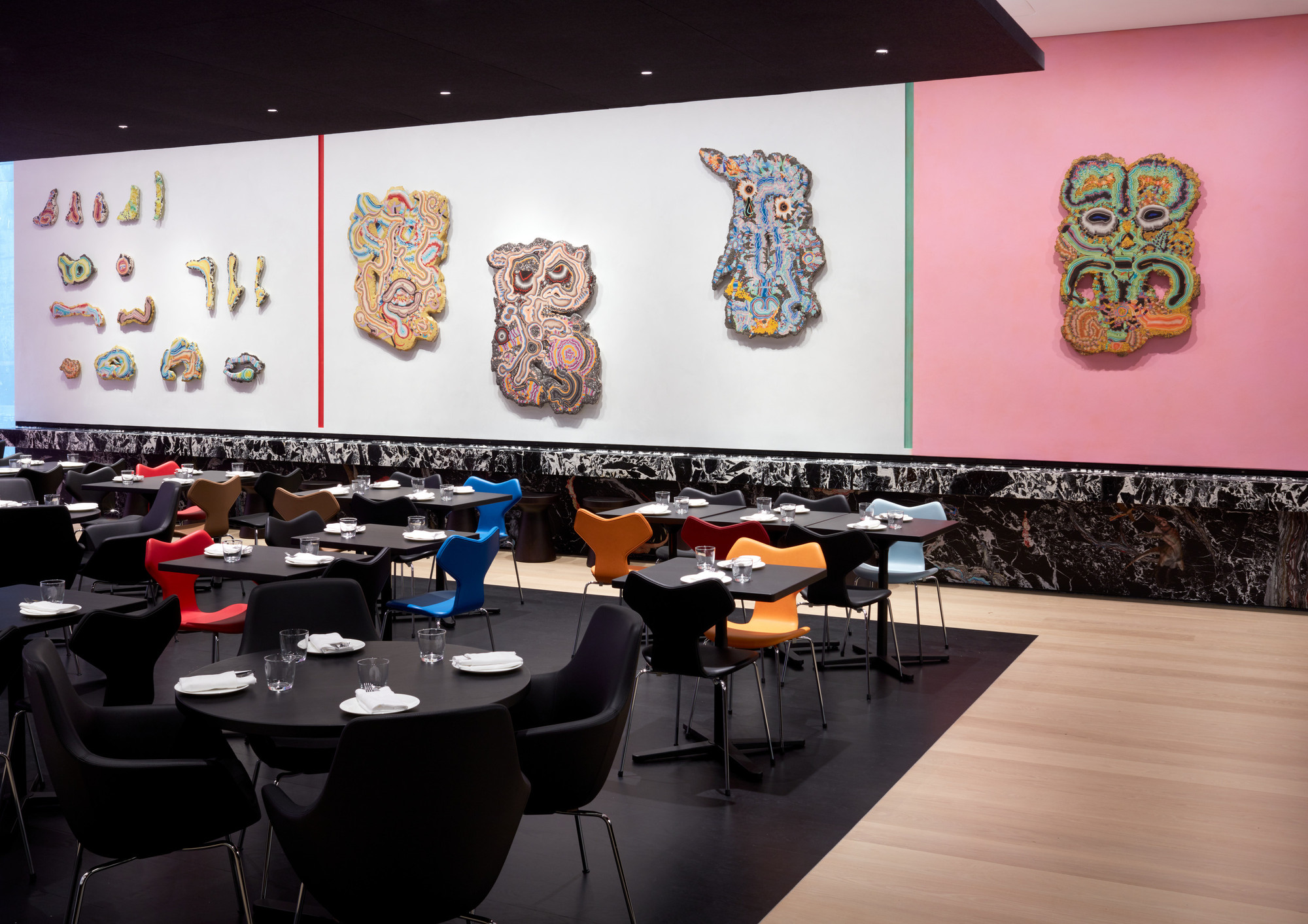 Installation view of the commission Fossil Psychics for Christa. 2019. Stucco-marmo, tempera, Oracal 8300 Transparent Cal 089, vinyl, and Venetian plaster. Digital Image © 2019 The Museum of Modern Art, New York. Photo: Heidi Bohnenkamp