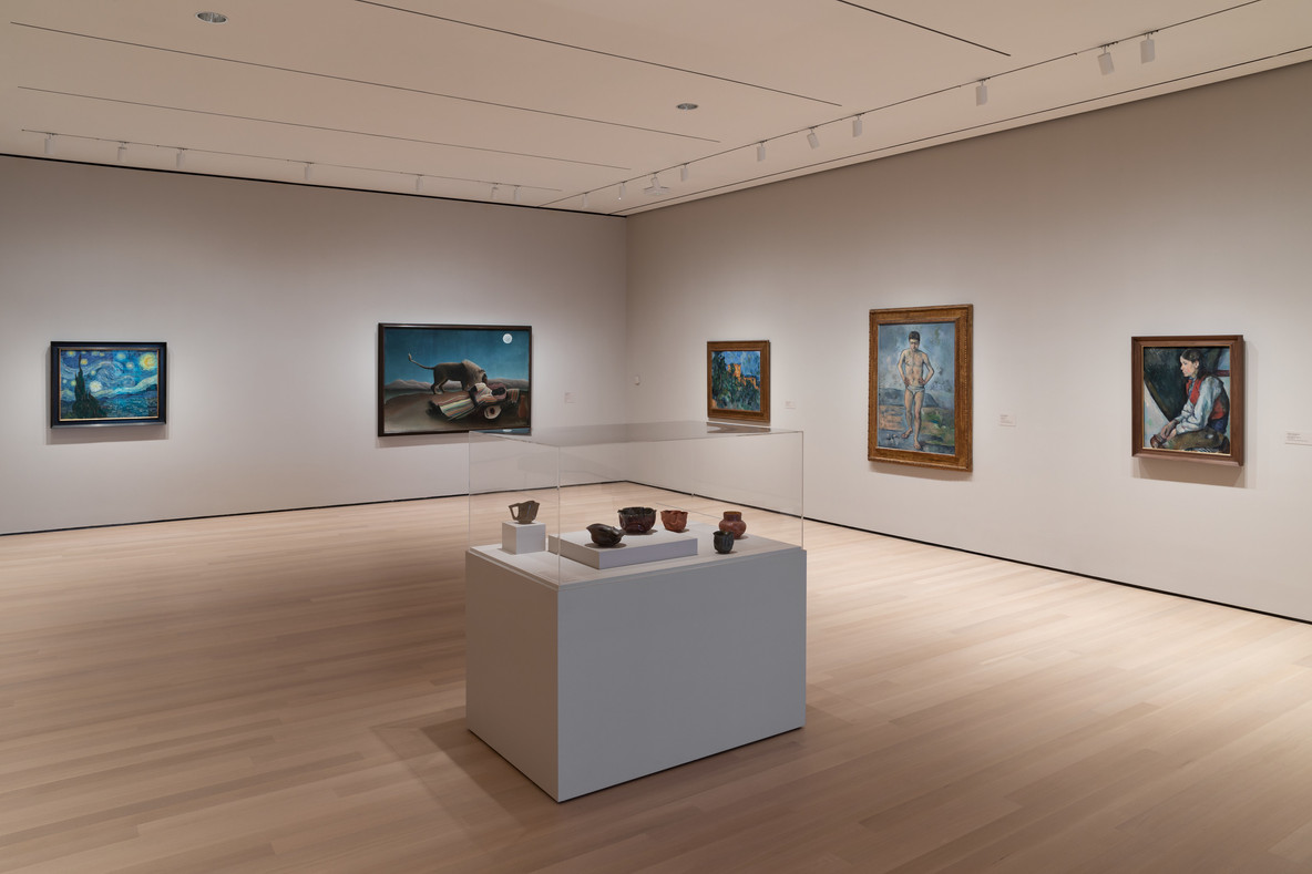 A gallery view with George Ohr's early-1900s ceramics in the foreground