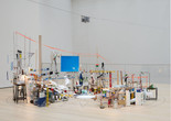 "Sarah Sze. Triple Point (Pendulum). 2013. Salt, water, stone, string, projector, video, pendulum, and other materials, dimensions variable, approximately 150 × 210 × 200"" (381 × 533.4 × 508 cm). Gift of the International Council of The Museum of Modern Art, Agnes Gund, Ronald S. and Jo Carole Lauder, and Sharon Percy Rockefeller, in honor of the 60th Anniversary of the International Council"