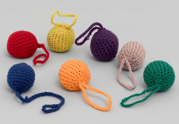 "J.L. Hammett Co. Gift 1: Balls, Kindergarten. 1898. Material based on the educational theories of Friedrich Froebel, Wool. 2"" (5.1 cm) each. Gift of Lawrence Benenson"