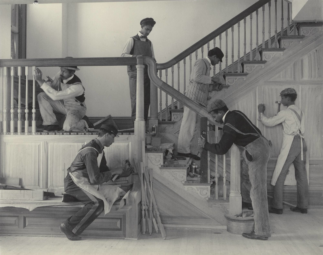 Frances Benjamin Johnston. Stairway of the Treasurer's Residence: Students at Work from the Hampton Album. 1899–1900