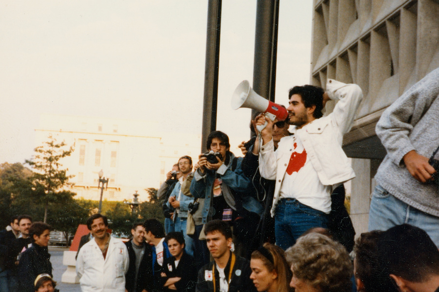 Gregg Bordowitz addressing a crowd in front of the Food and Drug Administration, Silver Spring, Maryland, 1988. Color snapshot. Courtesy the artist