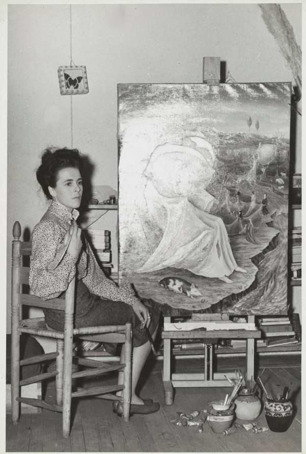 Leonora Carrington with her painting The Temptation of Saint Anthony