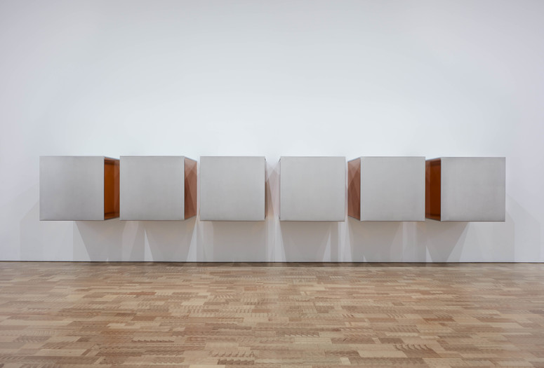 Donald Judd. Untitled. 1968. Stainless steel and amber Plexiglas; six units, each 34 × 34 × 34″ (86.4 × 86.4 × 86.4 cm), with 8″ (20.3 cm) intervals. Overall: 34 × 244 × 34″ (86.4 × 619.8 × 86.4 cm). Layton Art Collection Inc., Purchase, at the Milwaukee Art Museum. © 2020 Judd Foundation/Artists Rights Society (ARS), New York. Photo © John R. Glembin