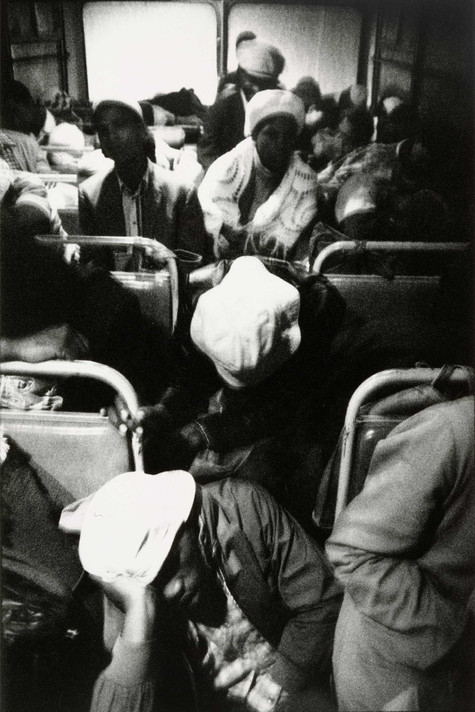 David Goldblatt. <em>The Transported of Kwa Ndebele: Going to Work – 3:30am Wolwekraal-Marabastad Bus, Standing Passengers Have Slumped to the Floor</em>. 1983