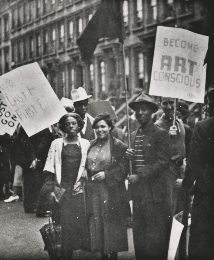 Harlem Artists' Guild and Artists' Union members picketing, late 1930s. Gwendolyn Bennett is at center, Norman Lewis is on the right; behind them in a white hat is Frederick Perry.