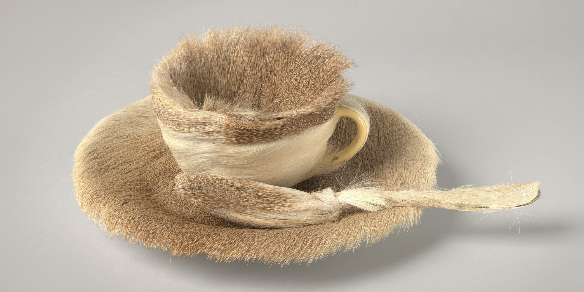 "Meret Oppenheim. Object. 1936. Fur-covered cup, saucer, and spoon; cup 4 3/8"" (10.9 cm) in diameter; saucer 9 3/8"" (23.7 cm) in diameter; spoon 8"" (20.2 cm) long, overall height 2 7/8"" (7.3 cm). Purchase. © 2020 Artists Rights Society (ARS), New York/Pro Litteris, Zurich"