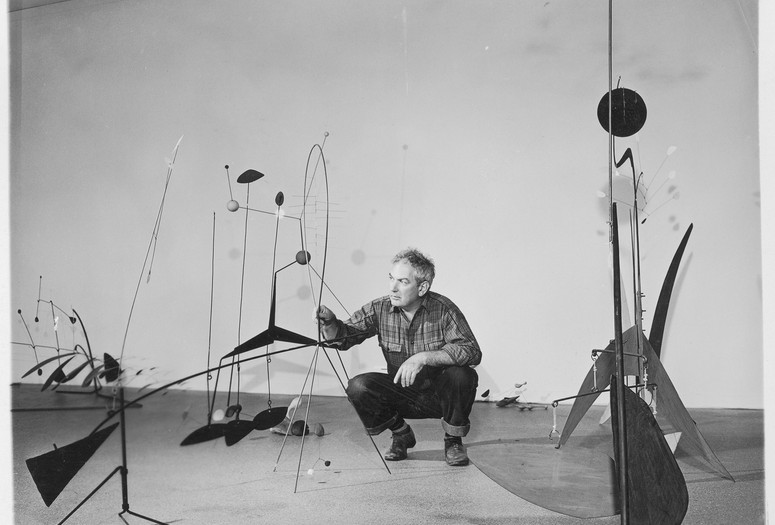 "Publicity photograph of Calder during the installation of ""Alexander Calder"" (September 29, 1943–January 16, 1944). 1943. Gelatin silver print, 3 3/4 x 4 3/4″ (9.5 x 12 cm). Photographic Archive, The Museum of Modern Art Archives, New York. © 2020 Calder Foundation, New York / Artists Rights Society (ARS), New York"